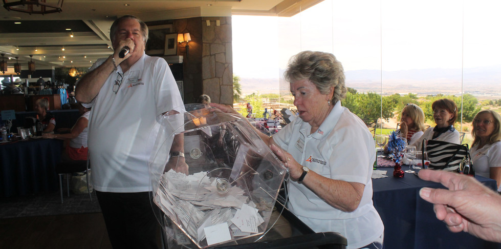 IMG_1311 craig and shirley ready to pull golf cart raffle ticket.JPG