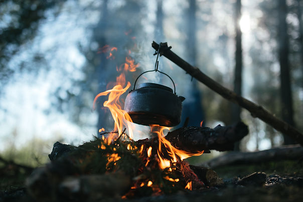 Cooking in a pot over campfire.jpg