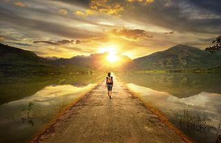 Walking down a beautiful path into the sunrise
