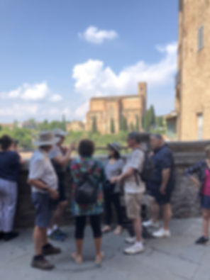 Enjoying a walking tour of Siena on our Best of Italy guided tour