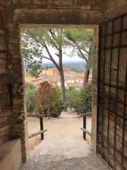View through a doorway in San Gimignano