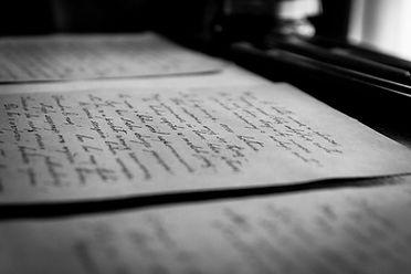 Hand-written documents on a desk