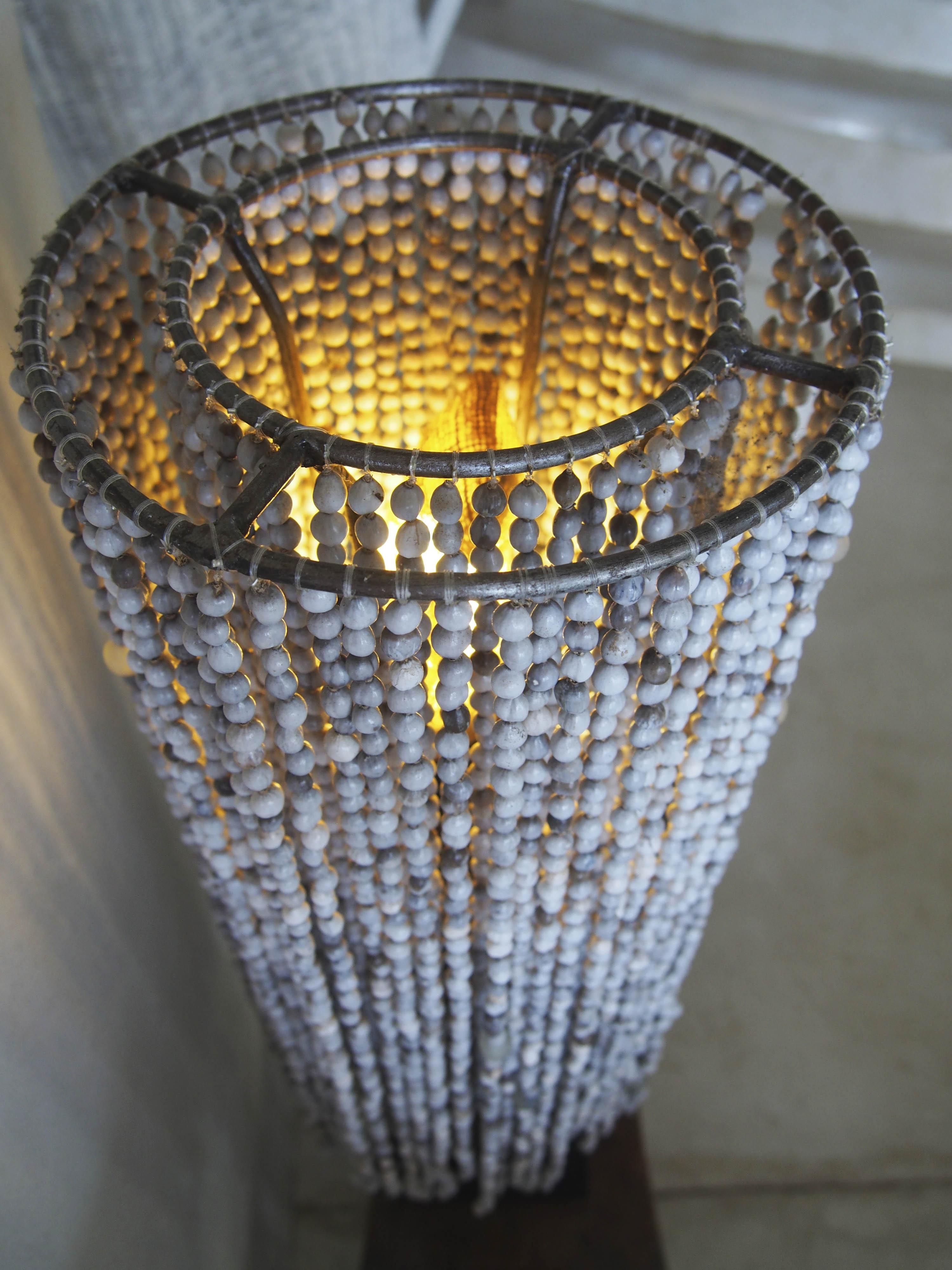 grey seed imfibinga lampshade handbeaded wall light