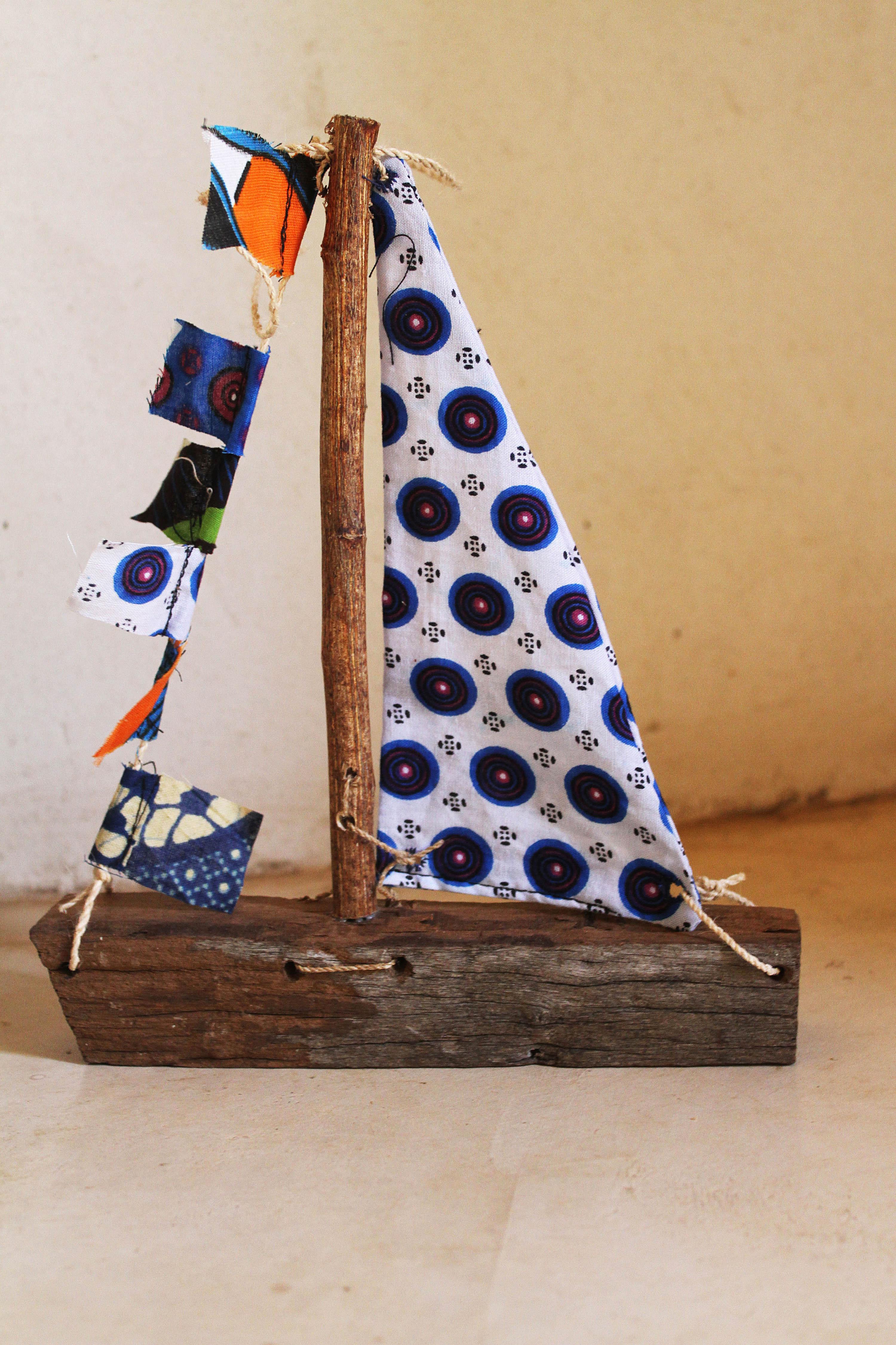 recycled boat wood toy boat lake malawi