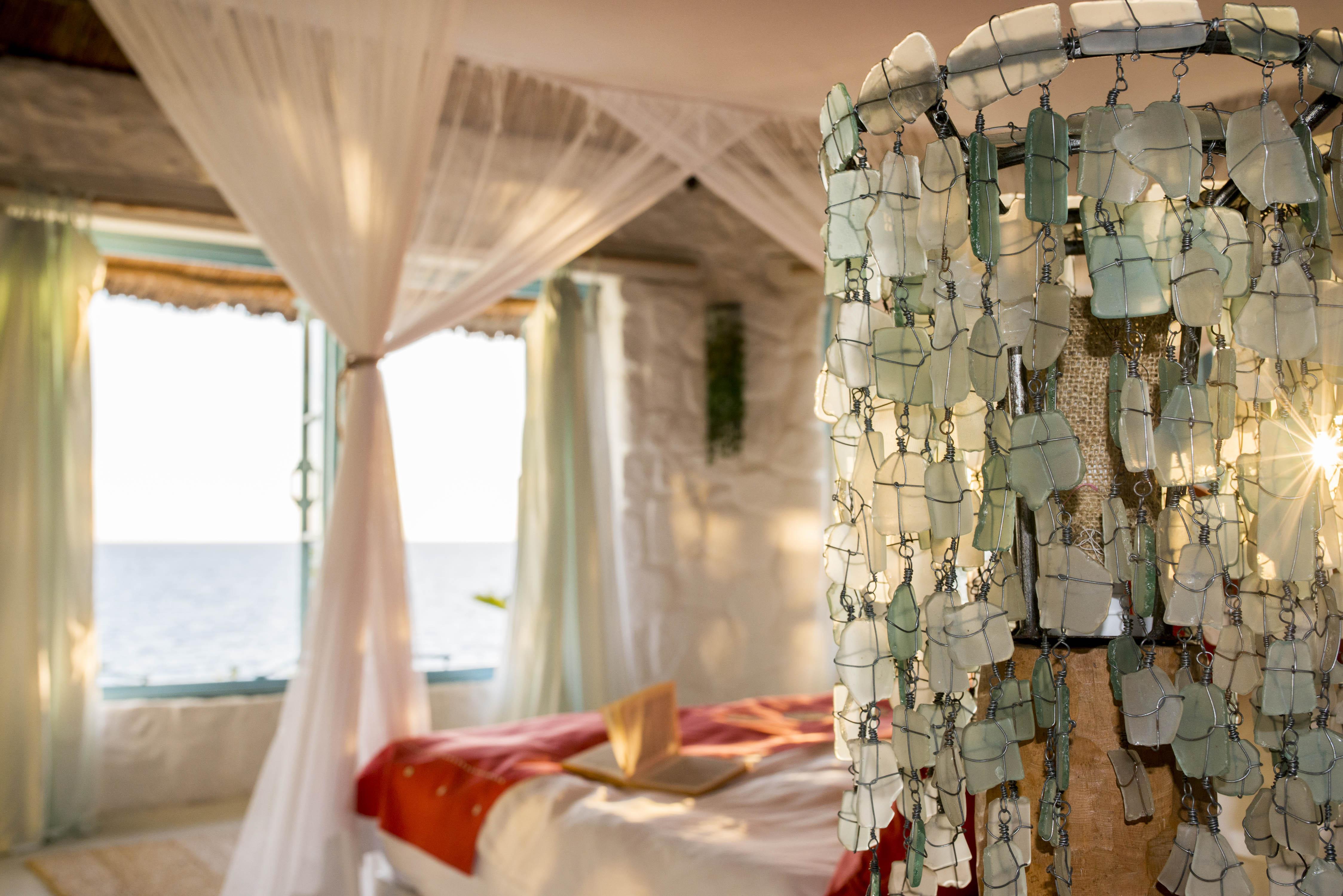 Kaya Mawa interiors tumbled glass lampshade