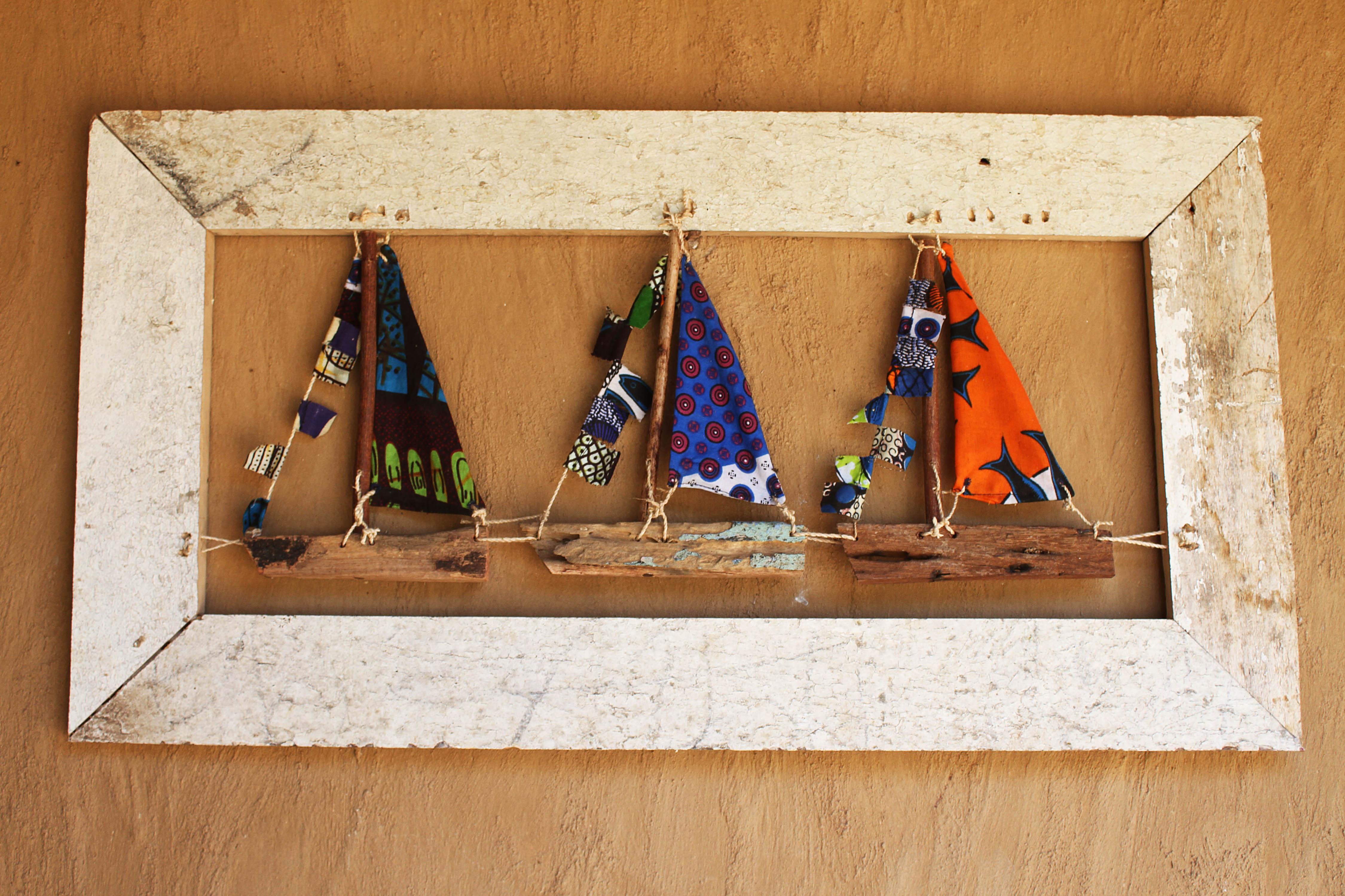 recycled boat wood three boats in frame lake malawi