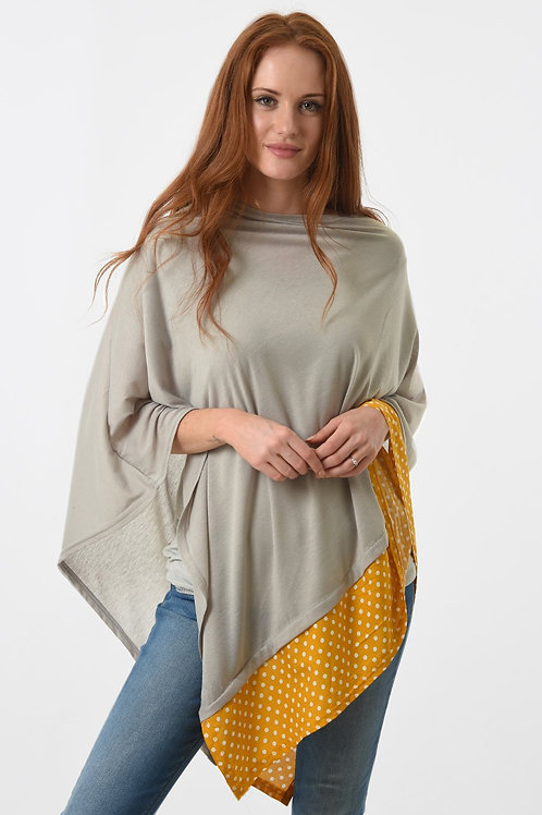 Poncho with polka dot trim
