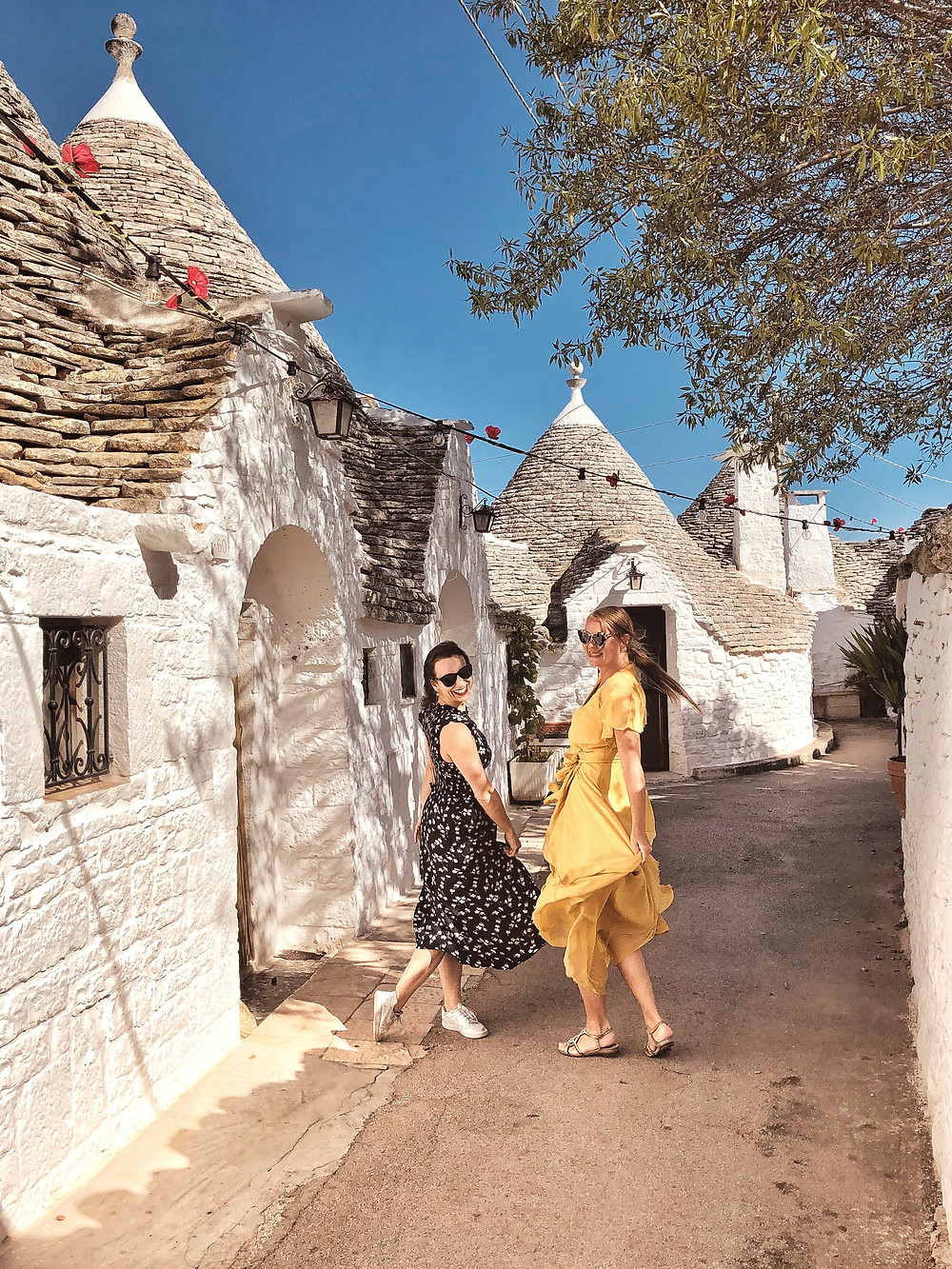 Dancing in the alleys of Alberobello-Puglia Italy