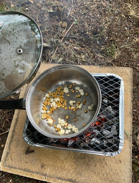 Toasting popcorn on our fire