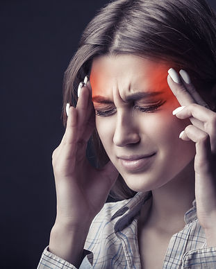 Young woman is suffering from a headache