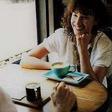 Make employer connections through American Job Centers Upper Shore Network. Shown: Woman and man discussing business over coffee.