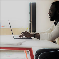 Learn about different careers that might interest you. Shown: Man at laptop.