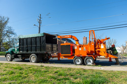 Eastern Tree Service truck and industrial wood chipper used to leave all job sites neat and tidy