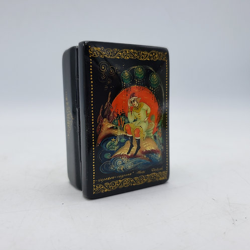 Small Black Lacquered Russian Signed Hinged Box of Person on Rock