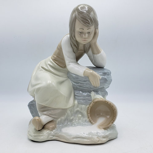 Nao Lladro Figure of Girl Sitting on Rock