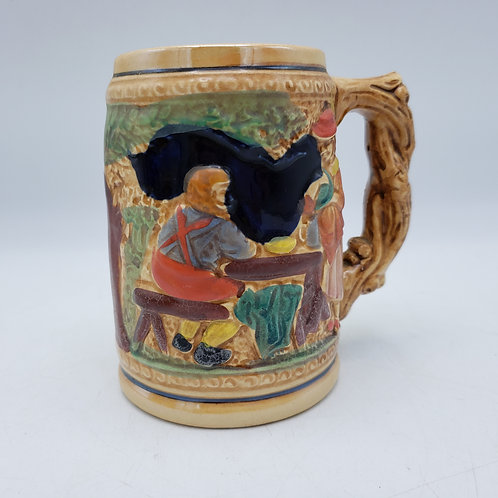 Vintage Beer Stein with Man at Table & Woman Standing