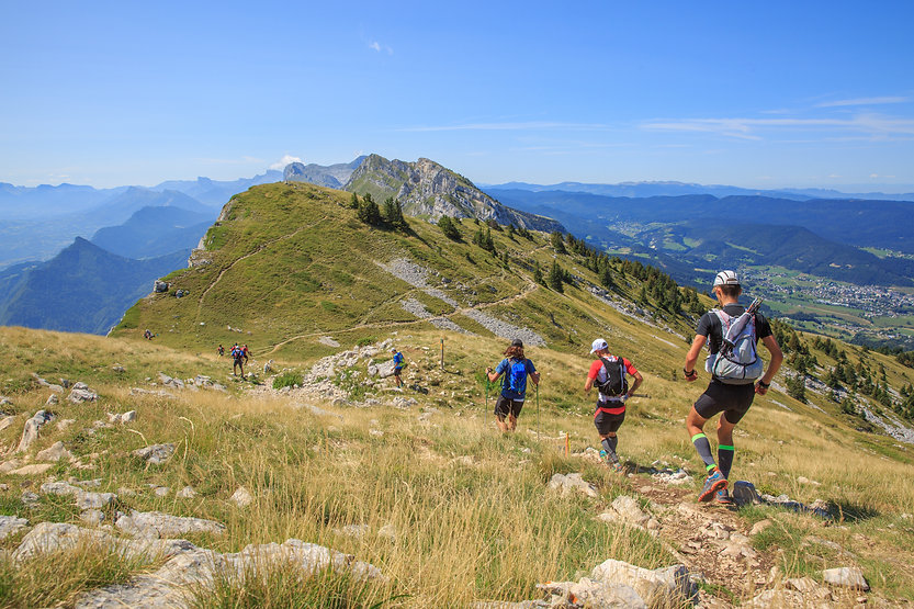 Trail runners running in the mountain in a sunny day.jpg