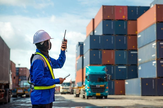 foreman using talking walkie talkie control loading containers box truck container.jpg