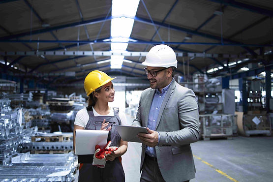 two people discussing in the manufacturing industry