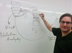 Researcher at whiteboard