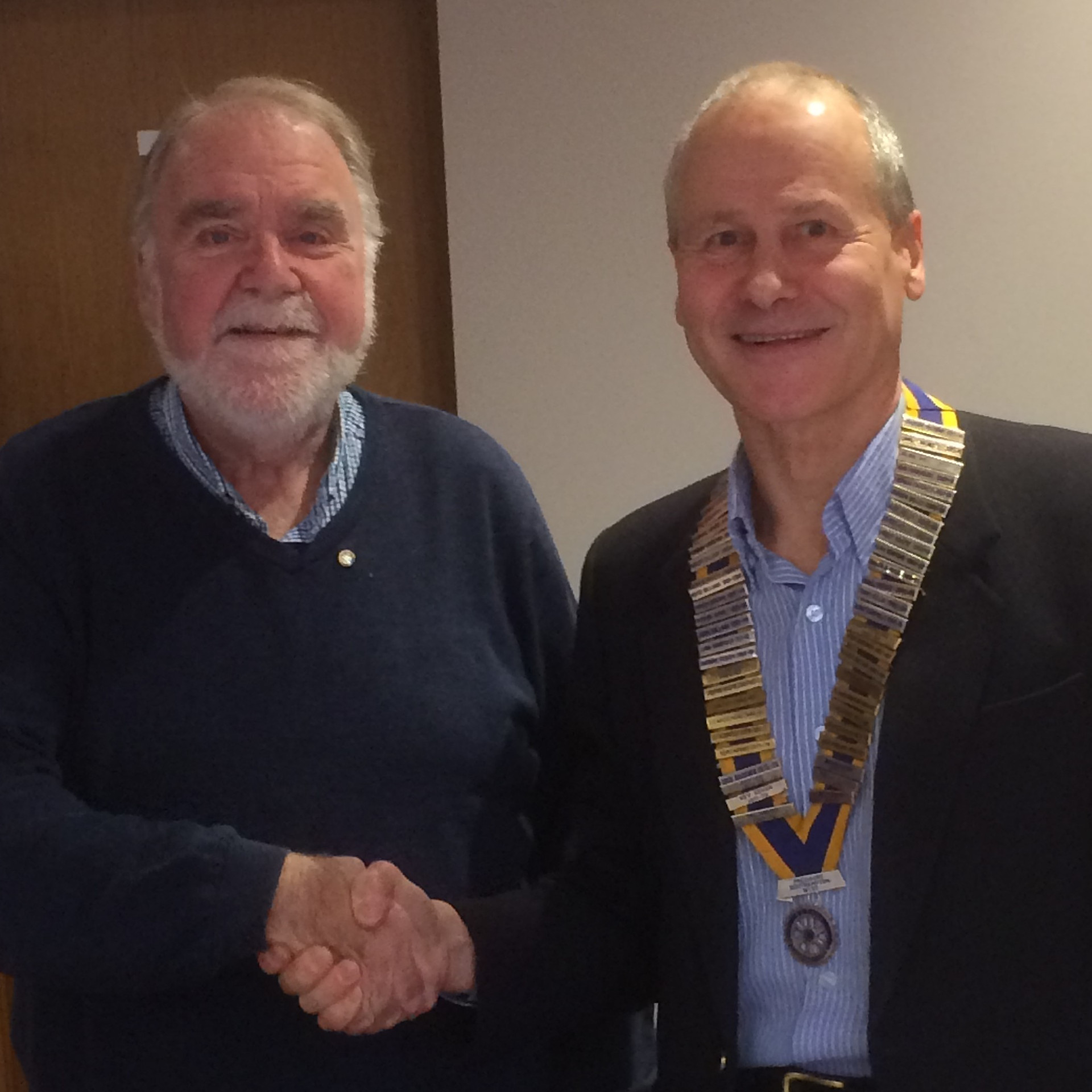 President Ralph welcomes new club member John Evett.