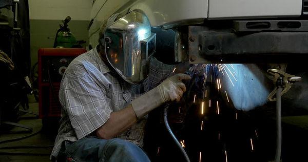 520330798-underbody-car-mechanic-welder-