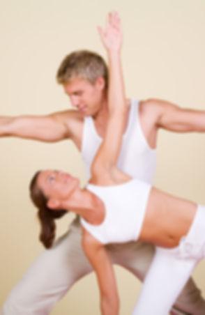female) doing yoga exercises together.j