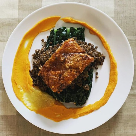 slow-cooked pork belly with braised lentils, sweet potato purée and steamed cavolo nero