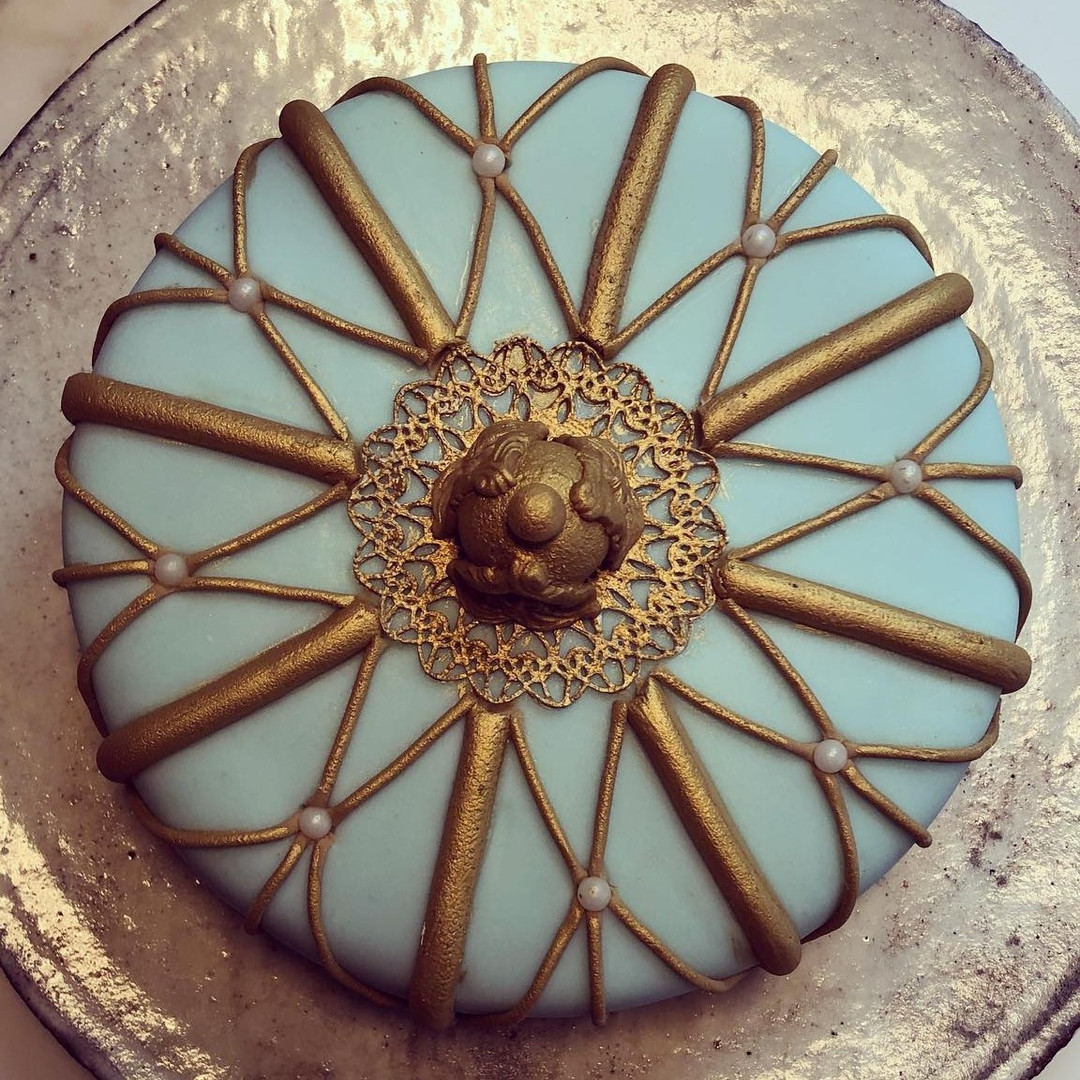Fruit cake with gilded details