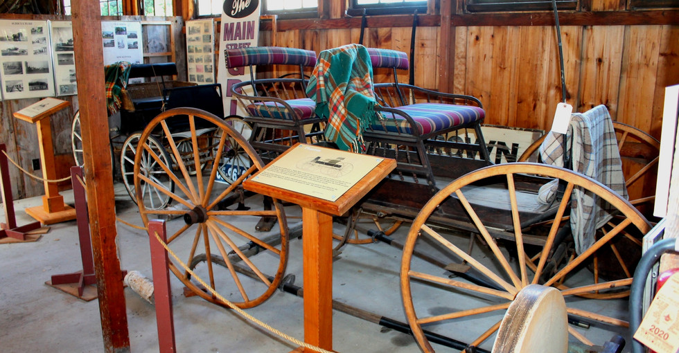 Carriages in Reichert family barn at Southold Historical Museum.JPG