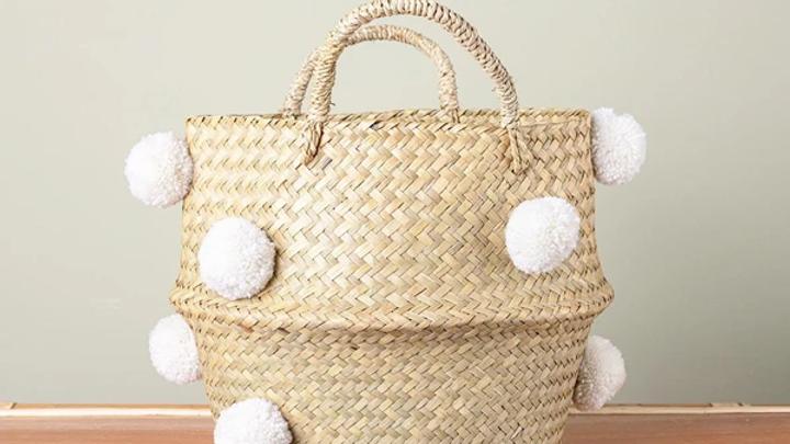 Rattan Basket with White Pom Poms.