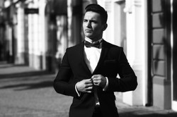 Young Man Unbuttons Suit Coat