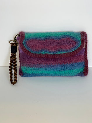 Small clutch with woven wrist handle