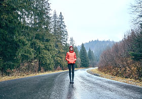 Girl Standing in Mountain Highway