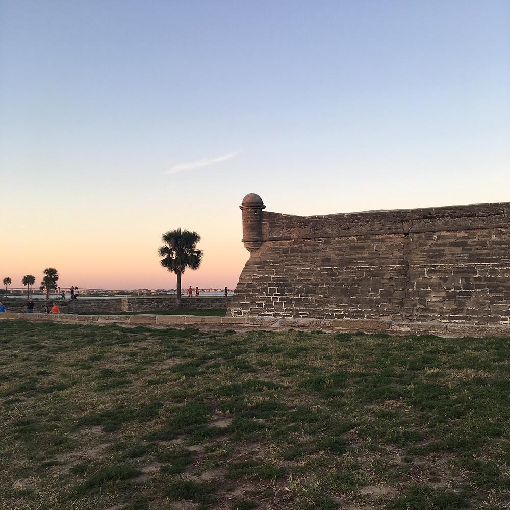 the fort Castillo de San Marcos in St. Augustine, FL at sunset