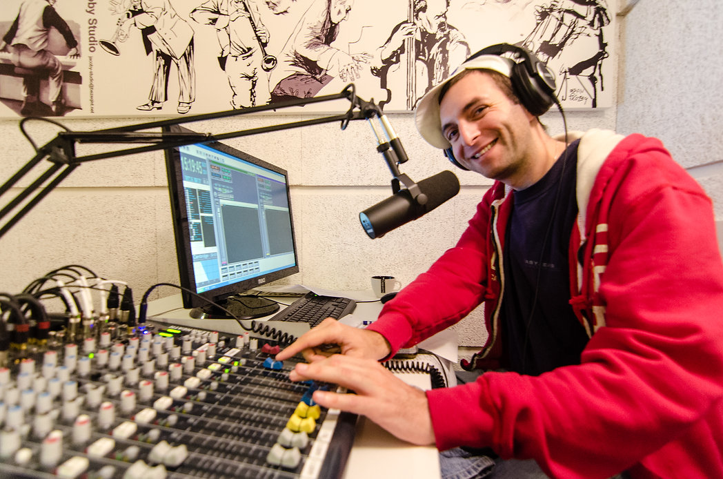 DJ Antithesis smiling in the Kol Cambridge Studio