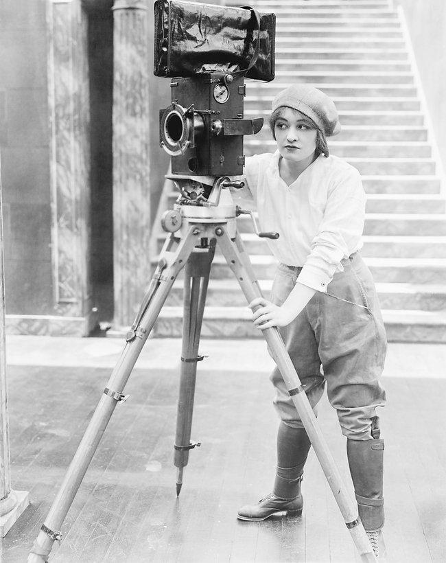 Woman operating movie camera_edited.jpg