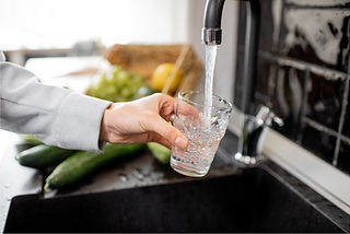 Water Glass filling at sink.jpg