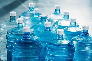 plastic-large-blue-water-bottles-on-floo