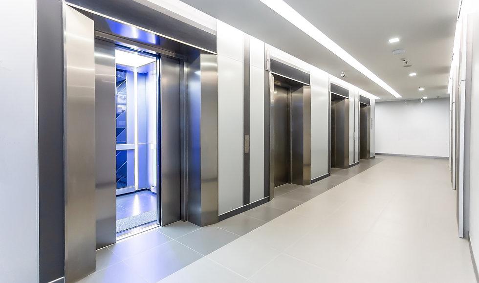 Modern steel elevator door open 50% cabins in a business lobby or Hotel, Store, interior,