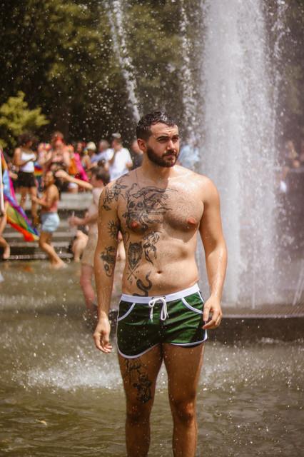 Shirtless Man in Fountain