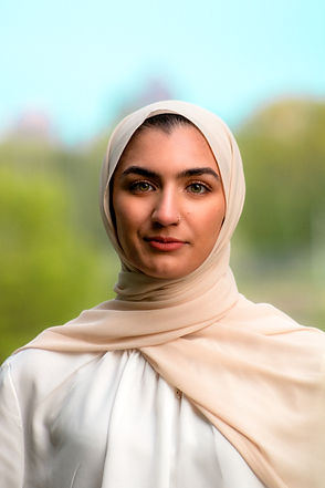 A girl with a hijab looking straight at the camera.