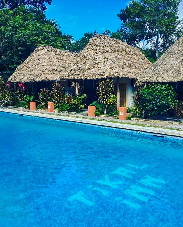 The beautiful huts at Tikal Inn