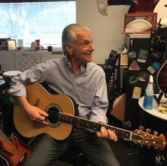 Playing Glen Campbell's own guitar.JPG