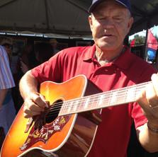 Glen Campbell playing Jim's guitar.JPG