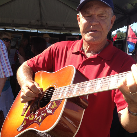 Glen Campbell playing Jim's guitar.JPG