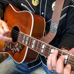 JC playing Gibson closeup.png