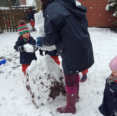 Making a snowman in the playground