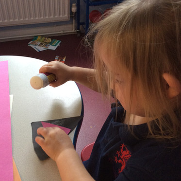 Sticking paper to make a big picture