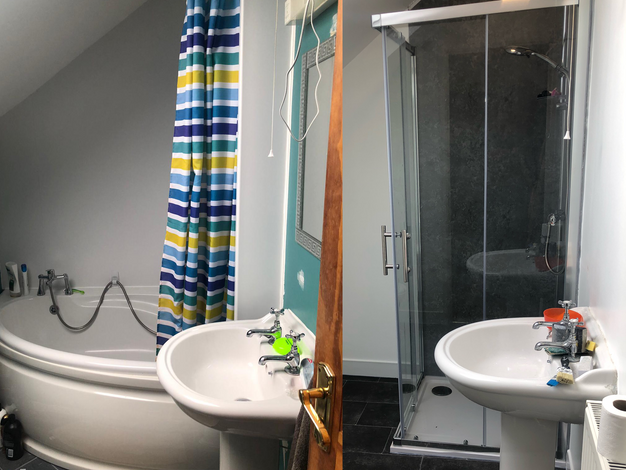 Bathroom before with bath and after with shower